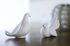 Two white bird figures stand Royalty Free Stock Photo