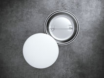 Two white blank badges on the concrete floor. 3d rendering. Two Blank badges on the concrete floor. 3d rendering Stock Photography