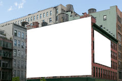 Two white blank billboard on the brick wall building. Two big, white, blank, billboard on the red brick building. On the roof visible water wooden tank stock photo