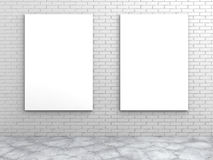 Two white blank frames on a brick wall Royalty Free Stock Images