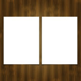 Two white blank sheet of paper on wooden background. Royalty Free Stock Photos