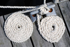 Two white boat ropes coiled up royalty free stock image