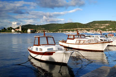 Boats against the cloudy blue sky. Two white boats against the some of Croatia island at summer time Stock Image
