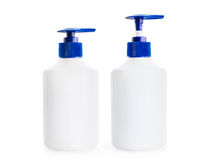 Two white bottle of liquid soap with a blue pump dispensers stock photo