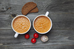 two white bowl with Tomato gazpacho soup with bread and garlic o Royalty Free Stock Photography