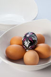 Two white bowls and easter eggs Royalty Free Stock Photos