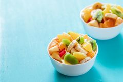 Two White Bowls Of Fresh Fruit Salad On Turquoise Table. Royalty Free Stock Photo