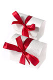 Two white boxes with  ribbons isolated on white Stock Image