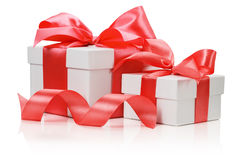 Two white boxes tied red ribbon bow  on the white backgr Stock Photography