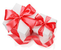 Two white boxes tied red ribbon bow  on the white. Background Stock Photos