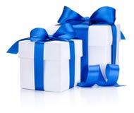 Two White boxs tied Blue satin ribbon bow Isolated on white. Background Stock Photos