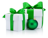 Two White boxs tied green satin ribbon bow and christmas ball Stock Images