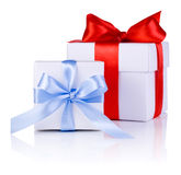 Two White boxs tied with Red and Blue ribbon bow Royalty Free Stock Photography