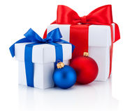 Two white boxs tied red and blue ribbon bow and christmas balls Royalty Free Stock Photo