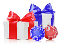 Two white boxs tied red and blue ribbon bow and christmas balls Royalty Free Stock Photos