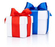 Two White boxs tied with Red and Blue satin ribbon bow Isolated. On white background Royalty Free Stock Images