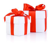 Two White boxs tied with a red satin ribbon bow Royalty Free Stock Photos