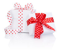 Two White boxs tied satin ribbon with heart symbol bow  Royalty Free Stock Image