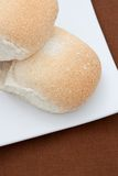 Two white bread buns Stock Images