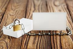 Two white business cards, lock, chain on wooden background . Protection of business and finance. Protection of personal informatio. N, earnings stock images