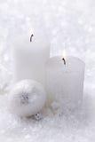 Two white candles Stock Photos