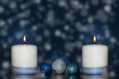 Two white candles with a blue ribbon Stock Photo