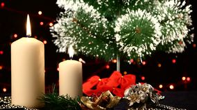 Two white candles with christmas decorations and stock footage