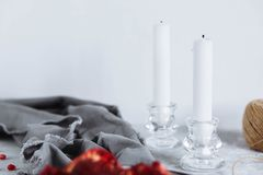 Two white candles on the table, close-up stock photography