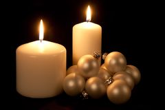 Two White Candles With Christmas Balls Royalty Free Stock Image