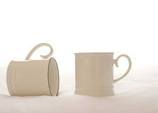 Two white ceramic coffee cup. On bed Royalty Free Stock Photography