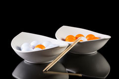 Two white ceramics bowls with golf balls Stock Image