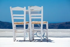Two white chairs Stock Photos