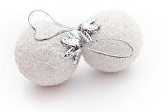 Two white Christmas balls. Two Christmas balls on white background royalty free stock image