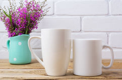 Two white coffee and cappuccino mug mockup with maroon purple fl Royalty Free Stock Photography