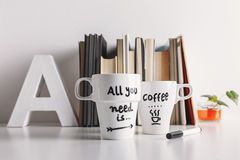 Two white coffee mug with diy decoration. Stock Photo