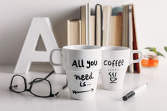Two white coffee mug with diy decoration. Royalty Free Stock Photo
