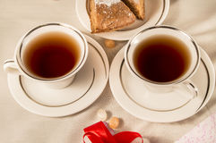 Two white cups with Apple pie. Red ribbon Stock Photography