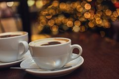 Two white cups with aroma refreshing coffee. Stock Photos