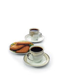Two white cups of black coffee and cookies Royalty Free Stock Image