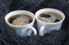 Two white cups with black coffee and foam Stock Photography