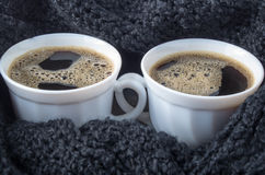 Two white cups with black coffee and foam Royalty Free Stock Image
