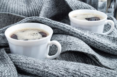Two white cups of coffee wrapped in scarf Stock Photography