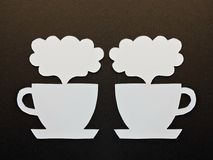 Two white cups cut from paper Royalty Free Stock Photos