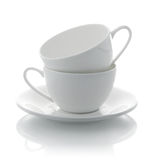 Two white cups and saucer. Two white cup and saucer on background Royalty Free Stock Photos