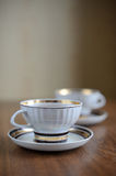 Two white cups of tea Stock Images