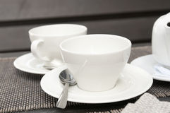 Two white cups and teapot Stock Photos