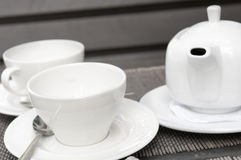 Two white cups and teapot Royalty Free Stock Images