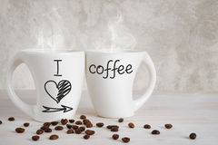 Two white cups with text I love coffee Stock Photography