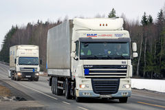 Two White DAF Cargo Trucks Platooning Stock Images