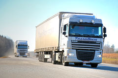 Two White DAF XF Semi Trucks on the Road Stock Images